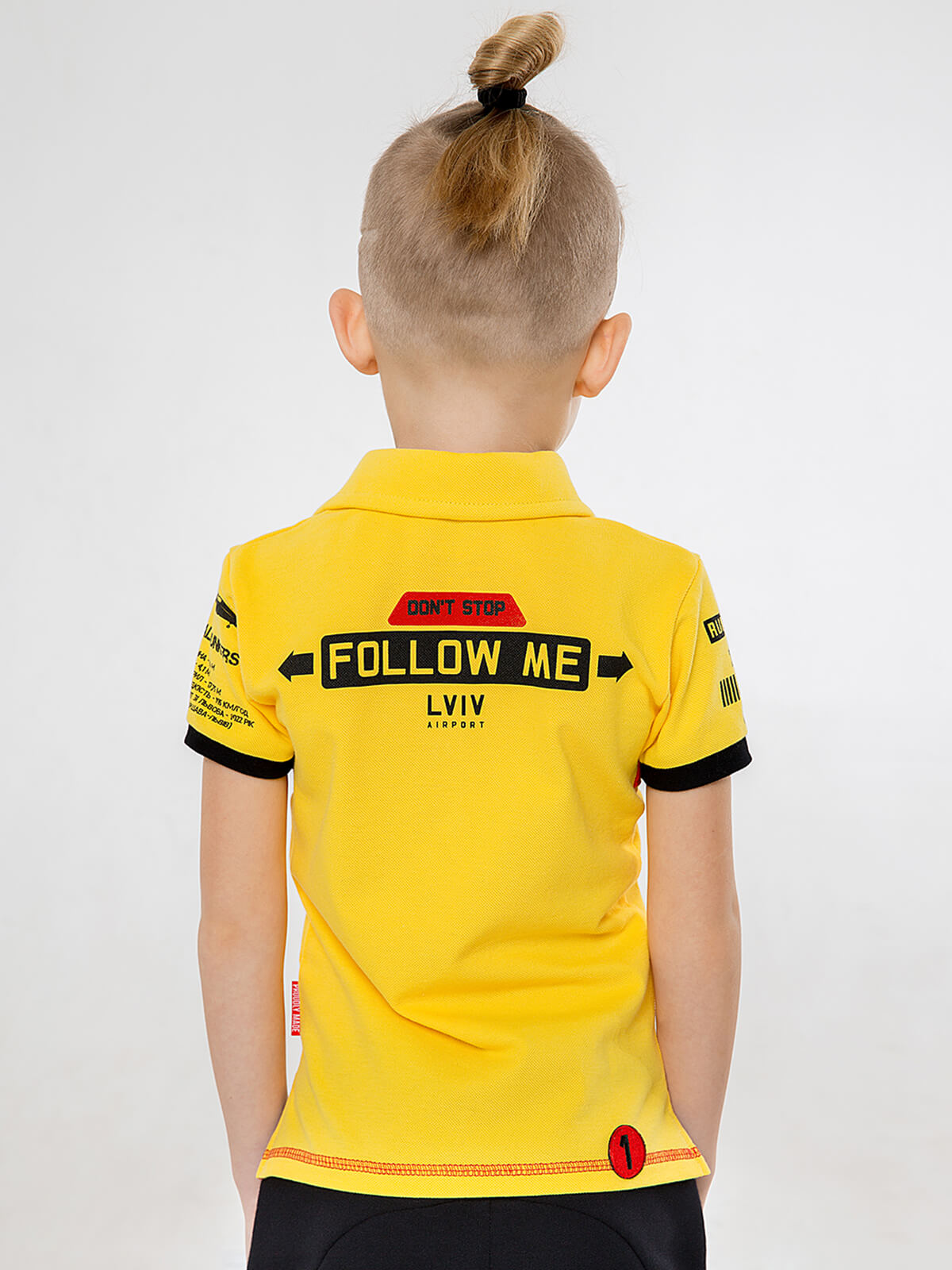 Kids Polo Shirt Follow Me. Color yellow.  Technique of prints applied: embroidery, silkscreen printing.