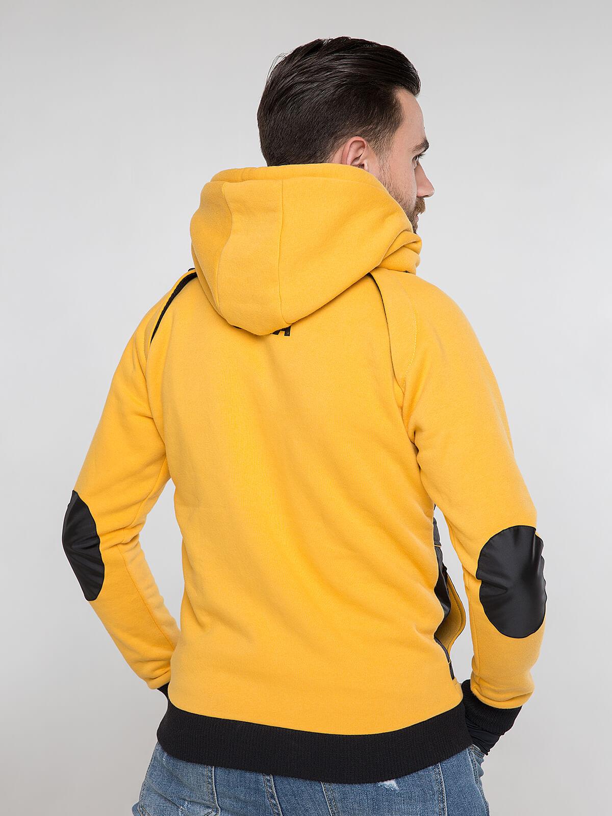 Чоловіче Худі Syla. Колір жовтий.  Матеріал худі – тринитка: 77% бавовна, 23% поліефір.