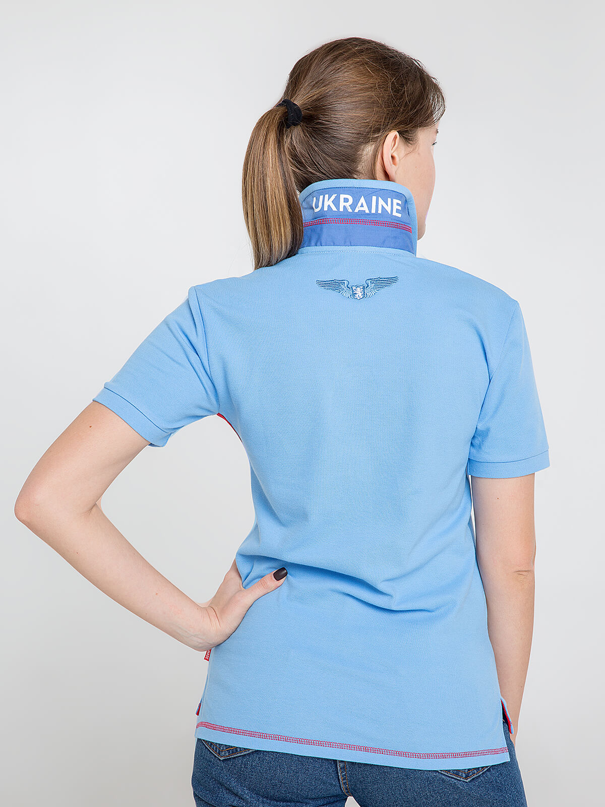 Women's Polo Shirt Wings. Color sky blue.  Pique fabric: 100% cotton.