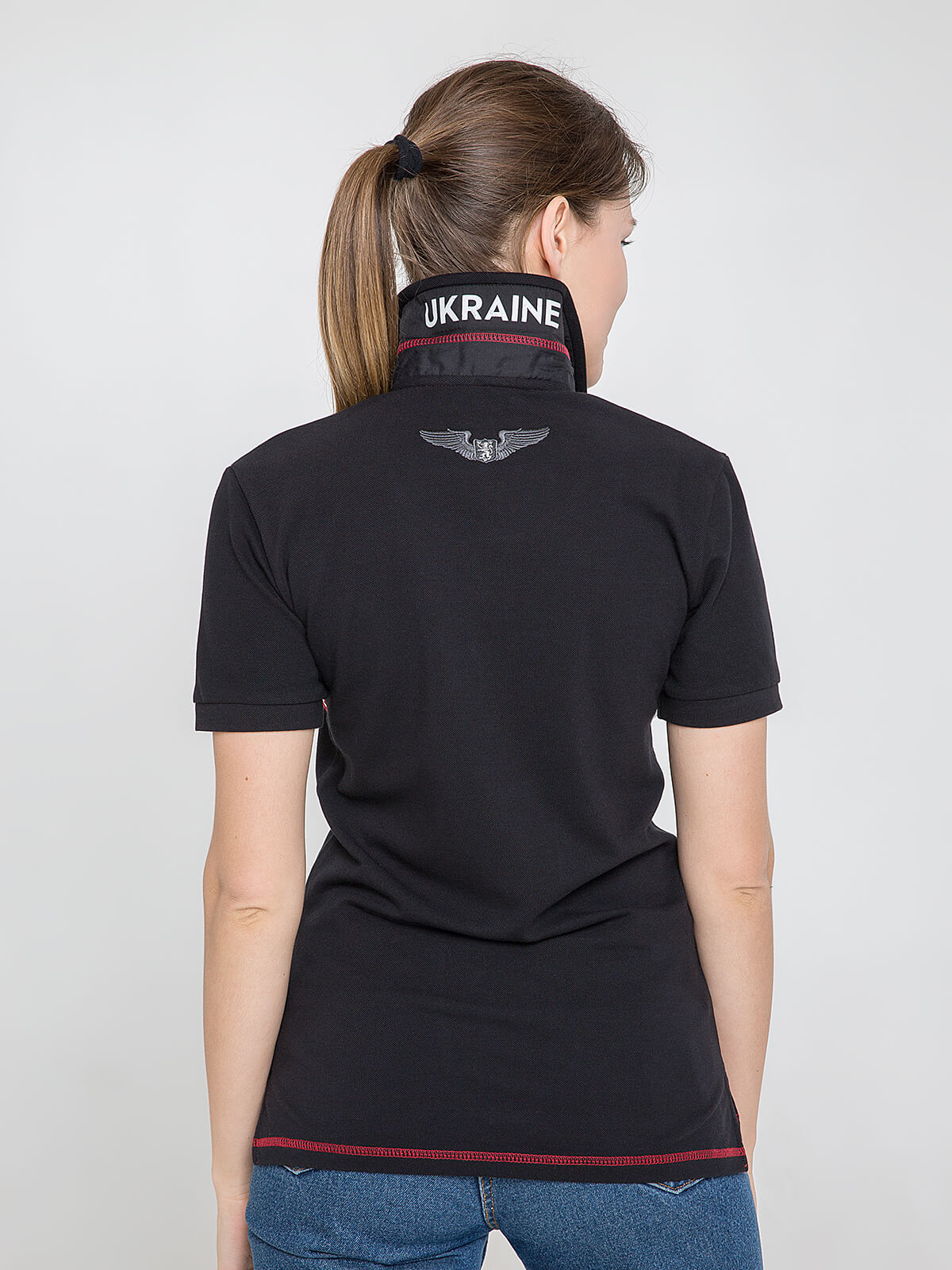 Women's Polo Shirt Wings. Color black.  Pique fabric: 100% cotton.