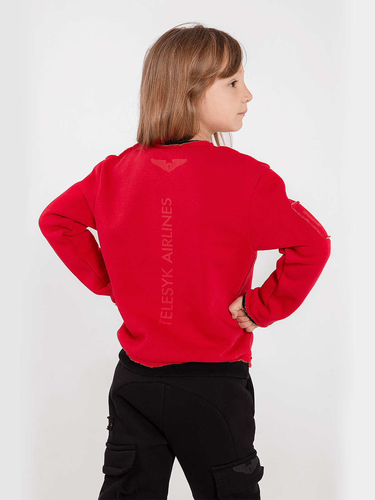 Kids Sweatshirt Forward. Color red.  Material: 77% cotton, 23% polyester.