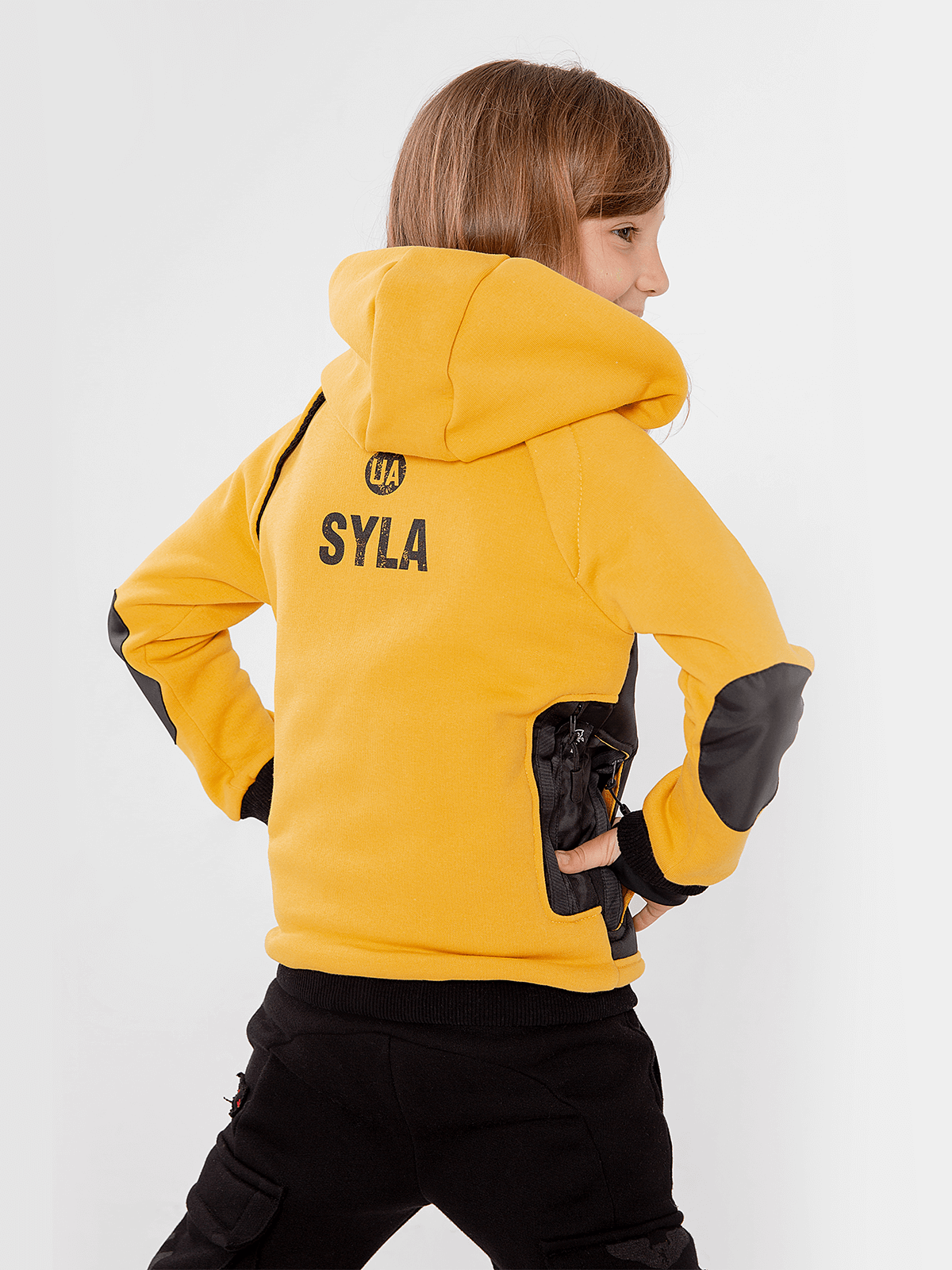 Kids Hoodie Syla. Color yellow.  Material of the inserts – oxford cloth, 100% polyester.