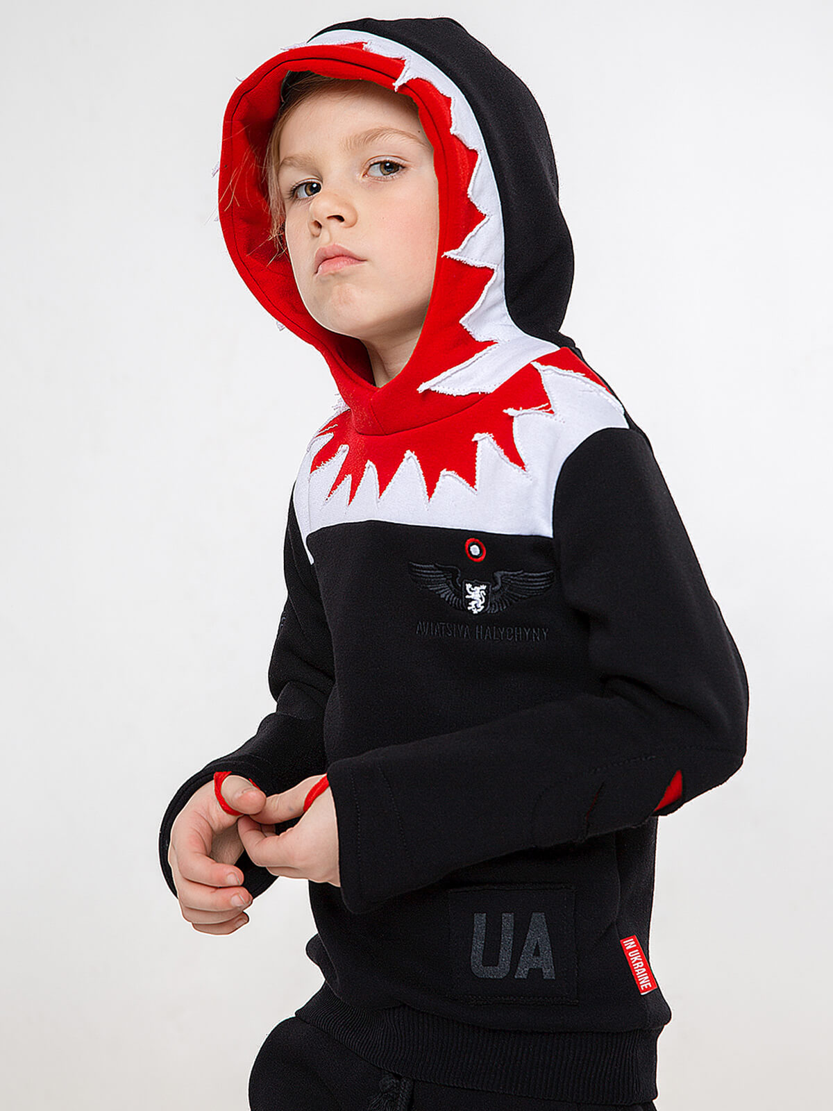 Kids Hoodie Jaws. Color black.  Technique of prints applied: silkscreen printing і embroidery.