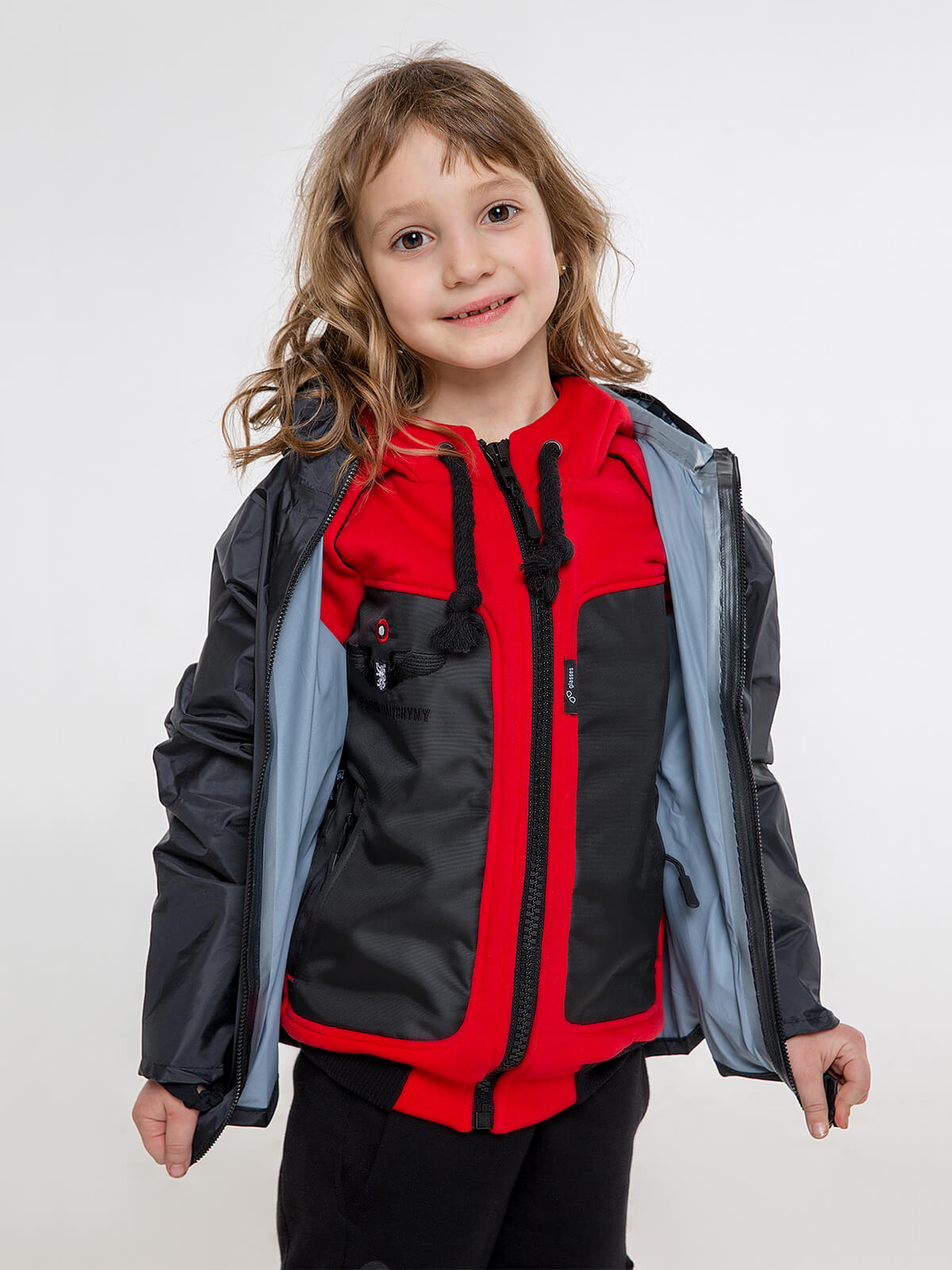 Kids Hoodie Syla. Color red.  Material of the inserts – oxford cloth, 100% polyester.