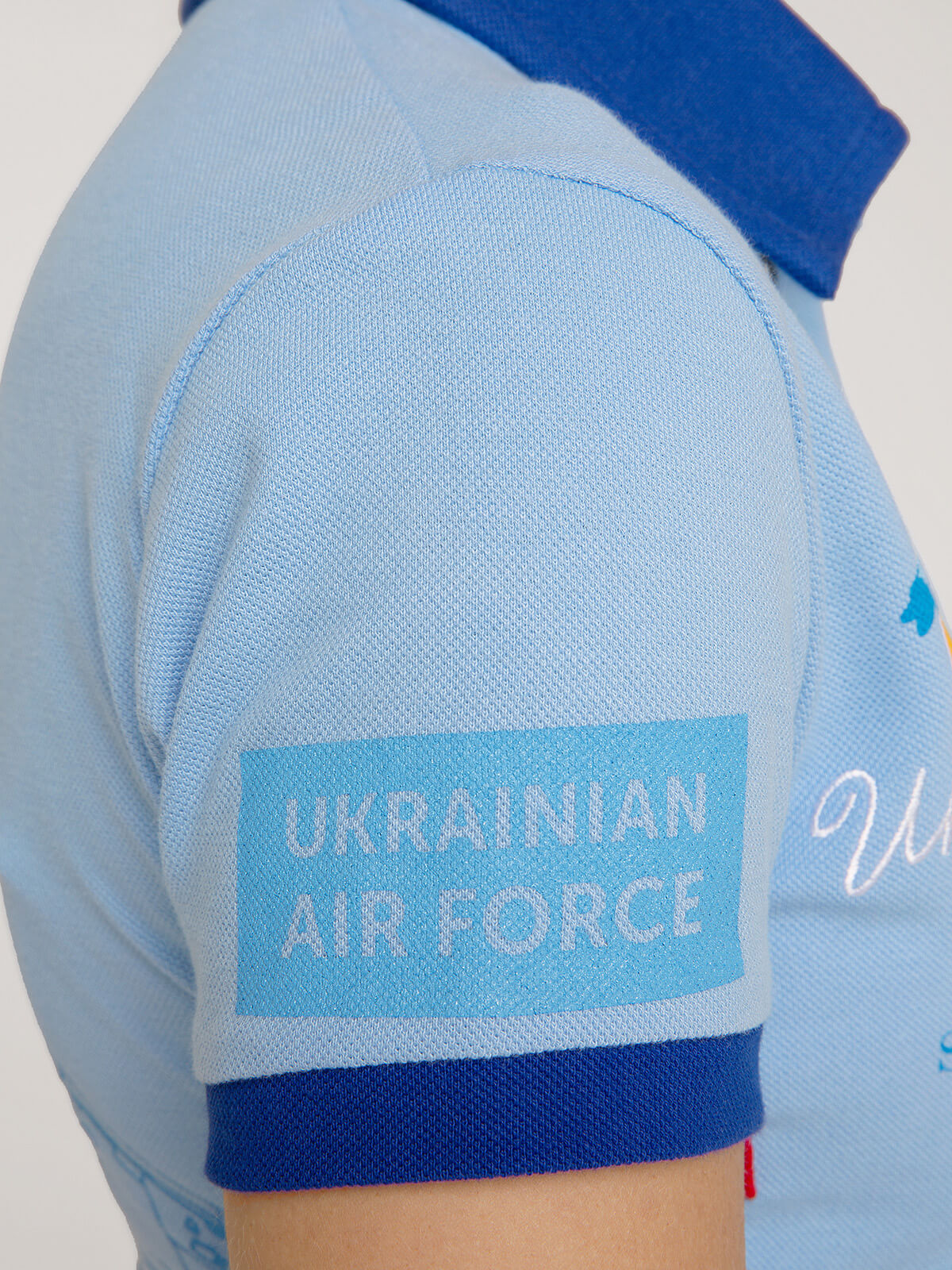 Women's Polo Shirt Ukrainian Falcons. Color sky blue.  Size worn by the model: S.
