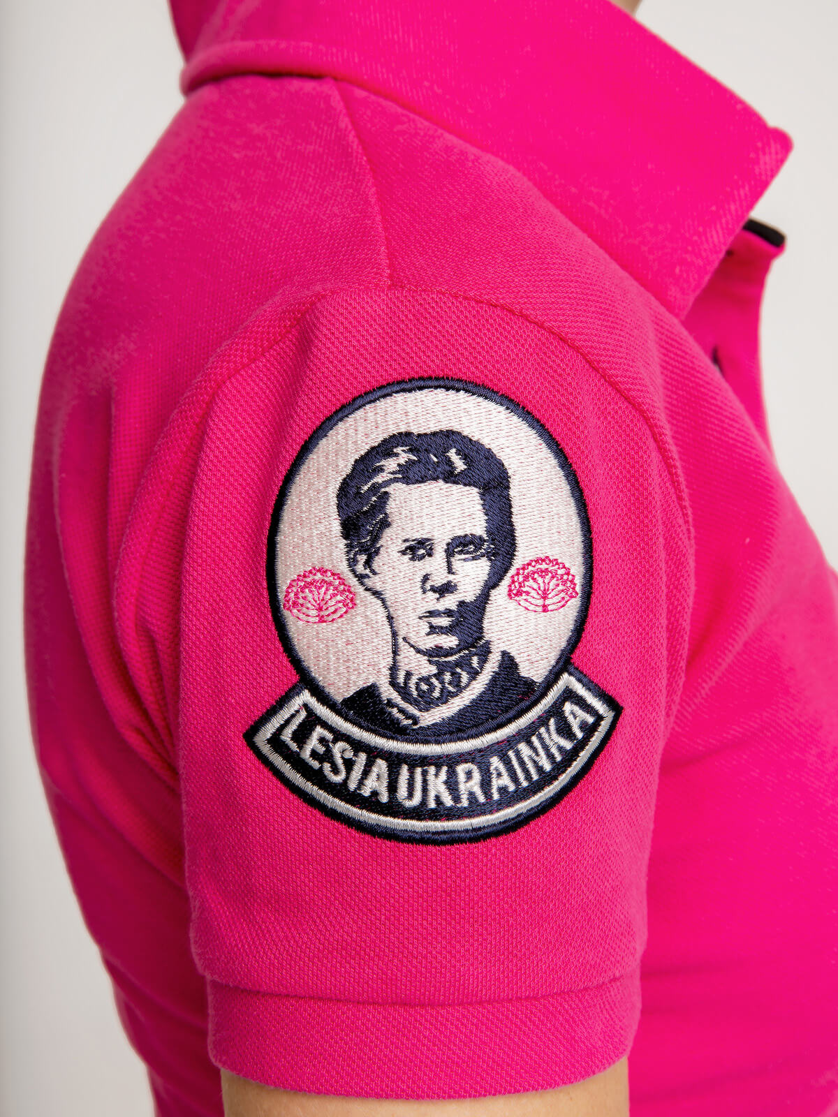 Women's Polo Shirt Lesia Ukrainka. Color pink.  Size worn by the model: S.