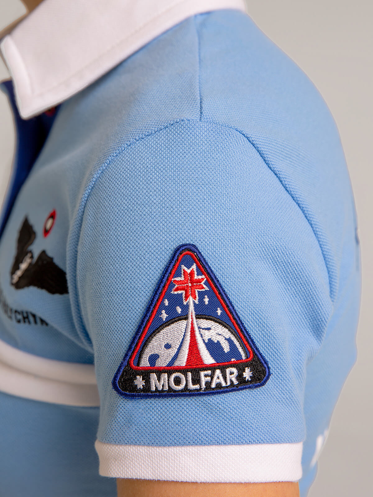 Women's Polo Shirt Molfar. Color sky blue.  Height of the model: 162 cm.