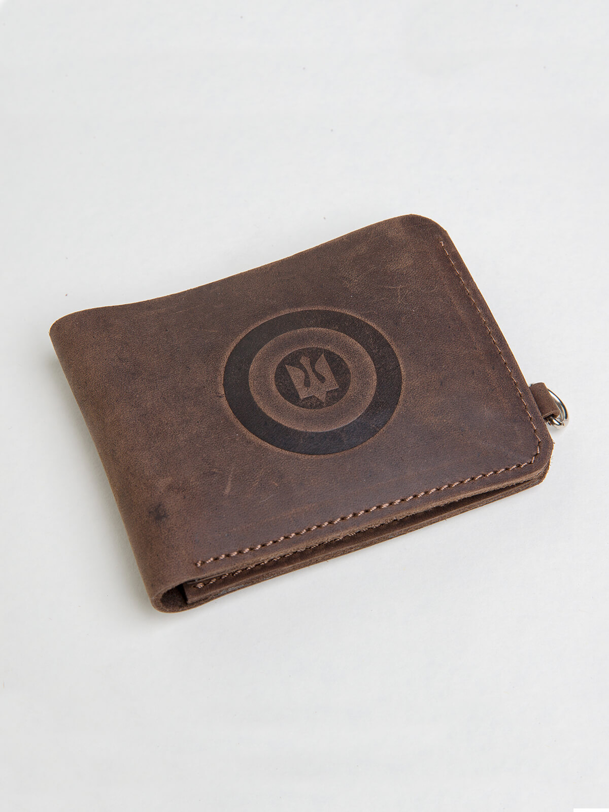 Wallet Roundel. Color brown. Material: leather Technique of prints applied: embossing.