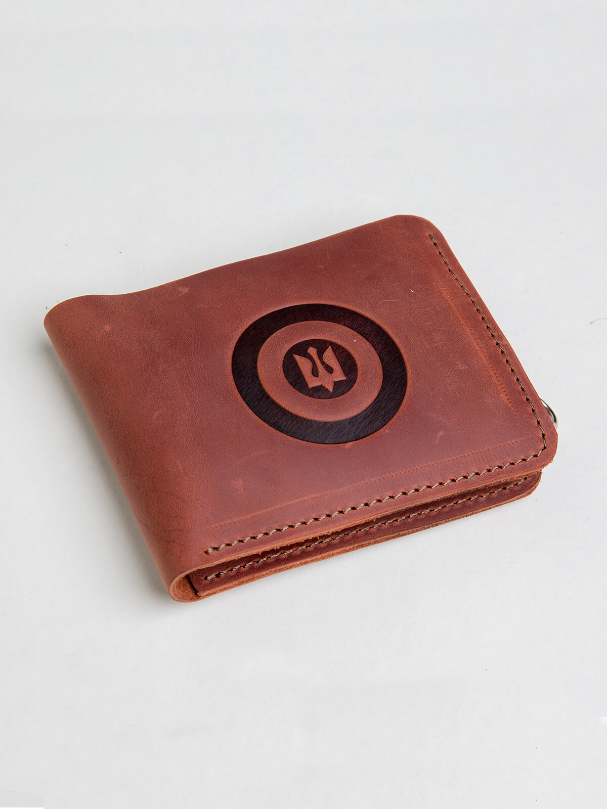 Wallet Roundel. Color light brown. Material: leather Technique of prints applied: embossing.