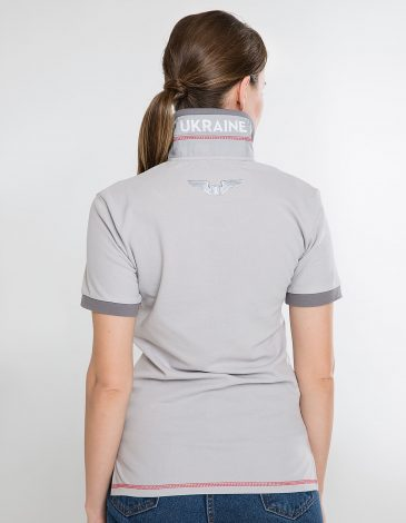 Women's Polo Shirt Wings. Color gray.  Size worn by the model: S.