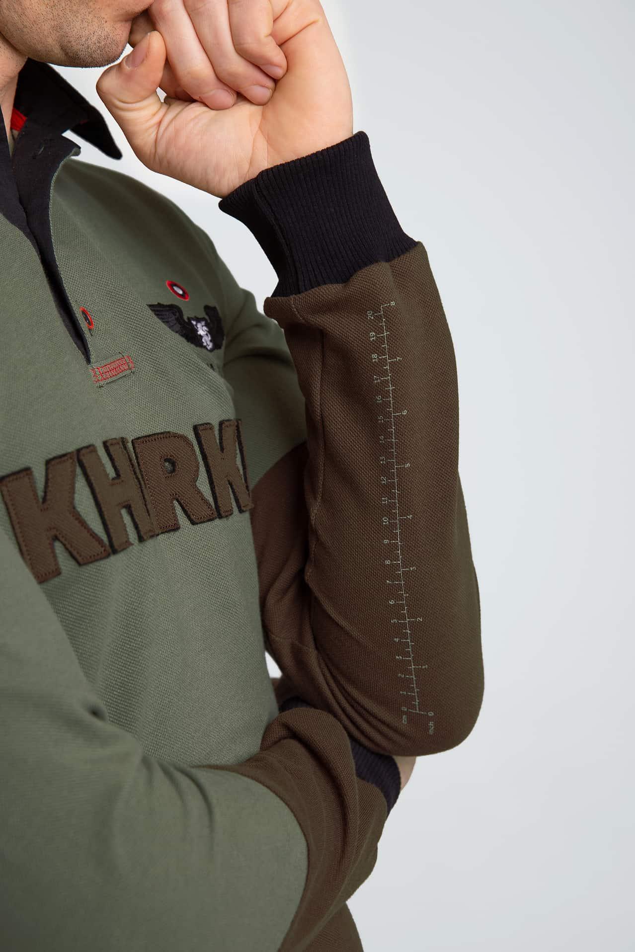 Жіноче Поло-Лонґ Kharkiv. Колір зелений.  Зріст моделі: 161 см.