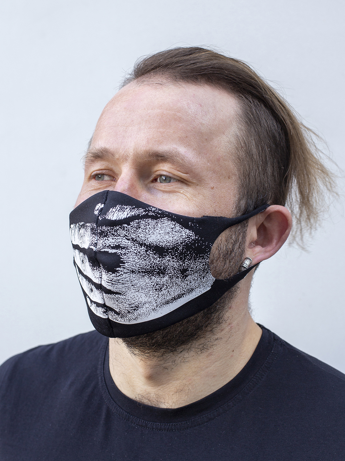 Mask Hand. Color black.  The cuts of the straps are soft and raw.