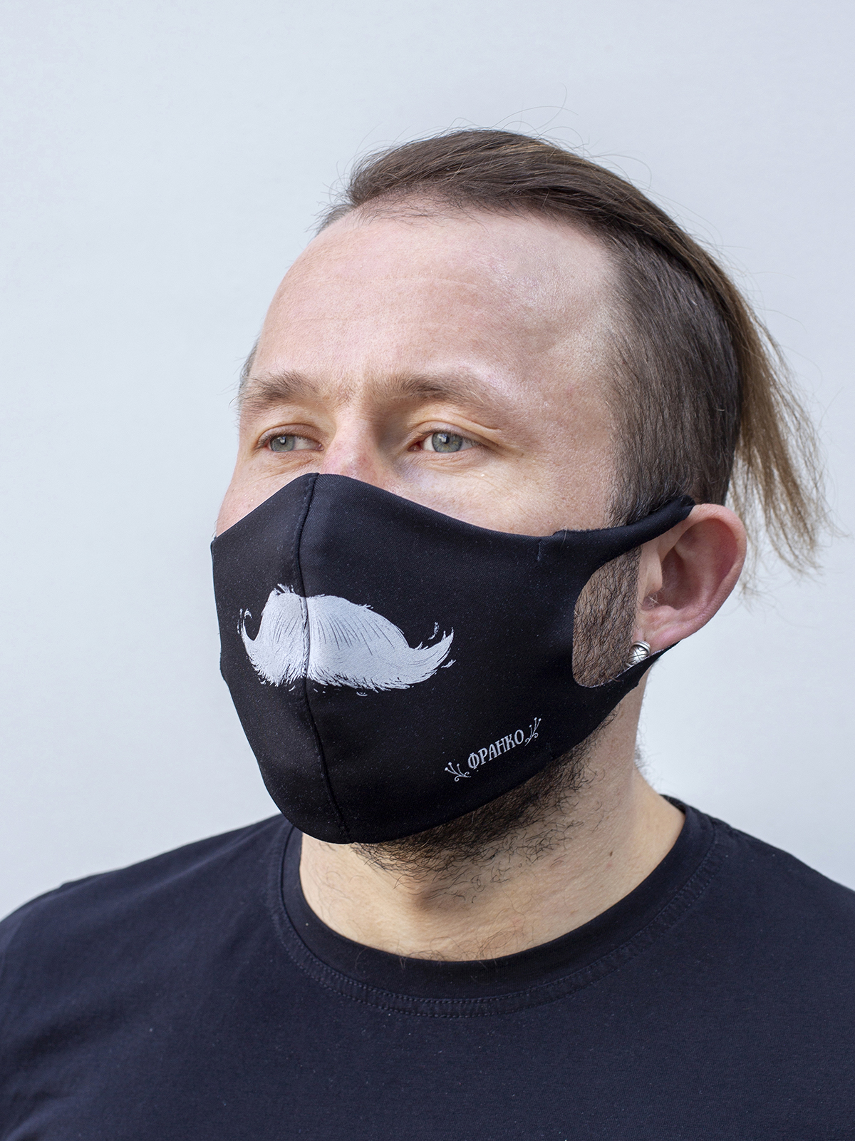 Mask Mustache. Color black.  There is a knitwear lining/pocket from the inside (95% cotton, 5% elastane) for the replaceable filter.