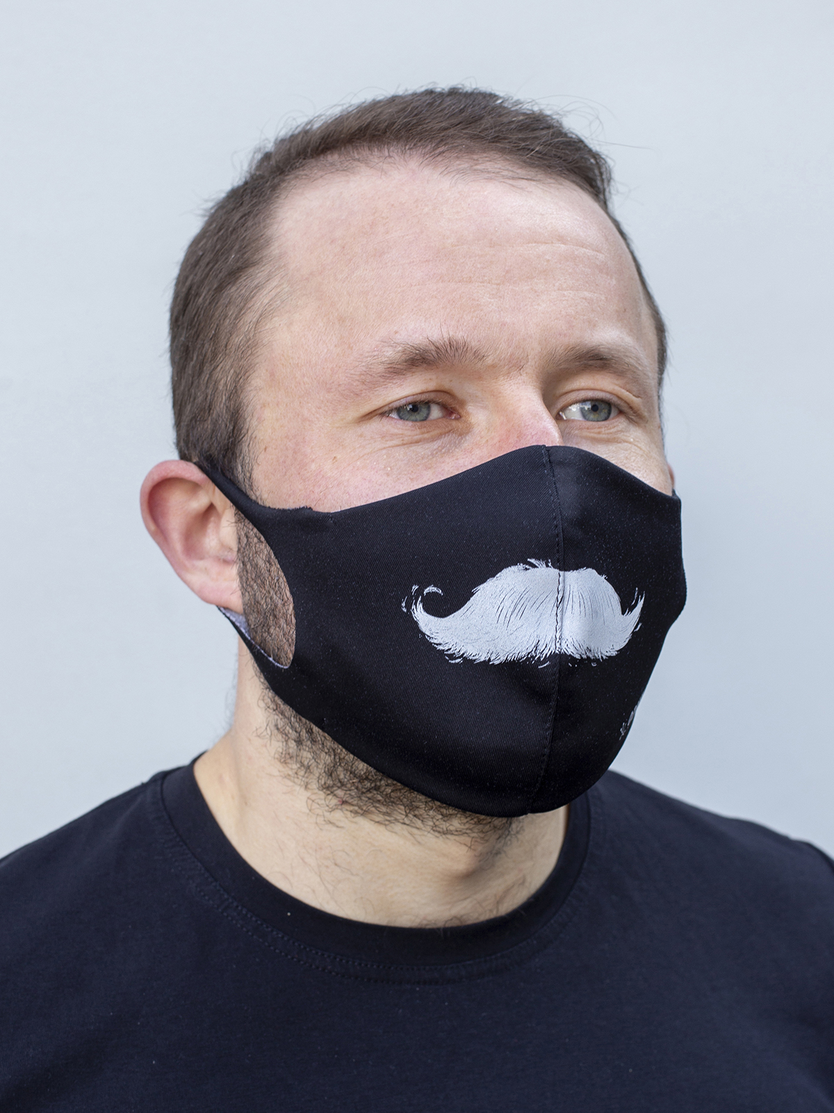 Mask Mustache. Color black.  The cuts of the straps are soft and raw.