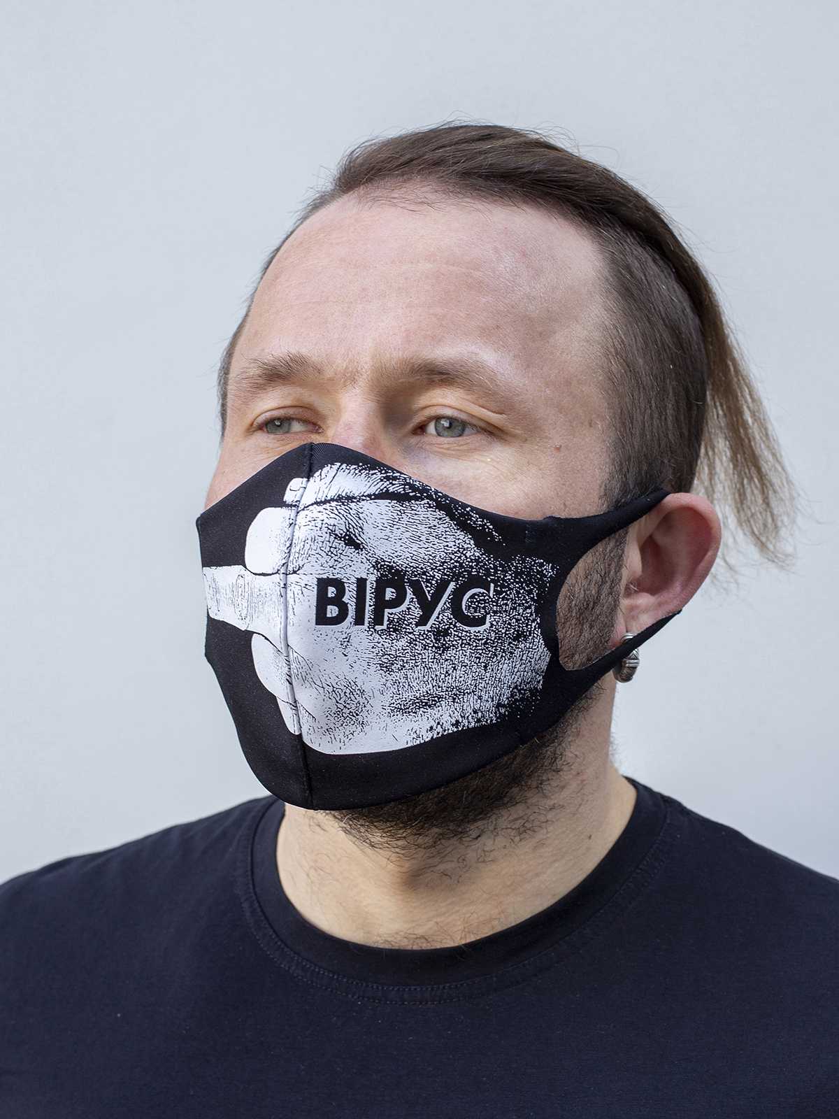 Mask F*ck Virus. Color black.  The cuts of the straps are soft and raw.