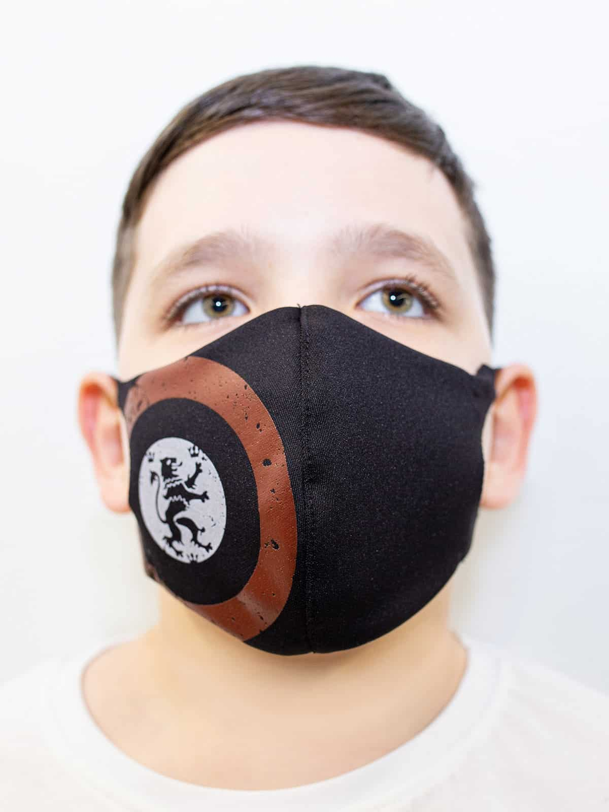 Kids Mask Lion (Roundel). Color black.  The cuts of the straps are soft and raw.