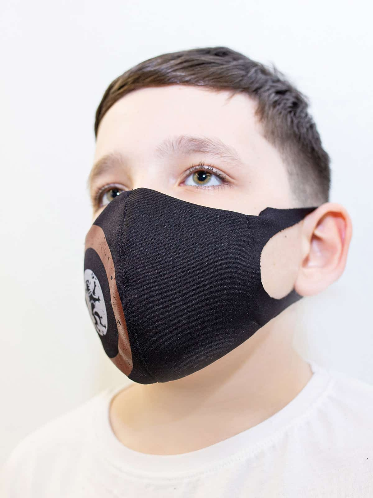 Kids Mask Lion (Roundel). Color black.  There is a knitwear lining/pocket from the inside (95% cotton, 5% elastane) for the replaceable filter.