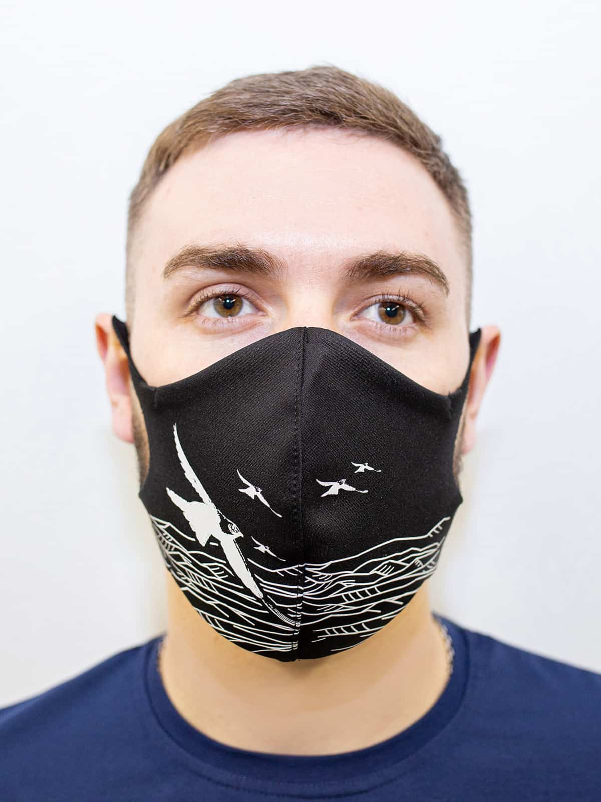 Mask Mountains. Color black.  The cuts of the straps are soft and raw.