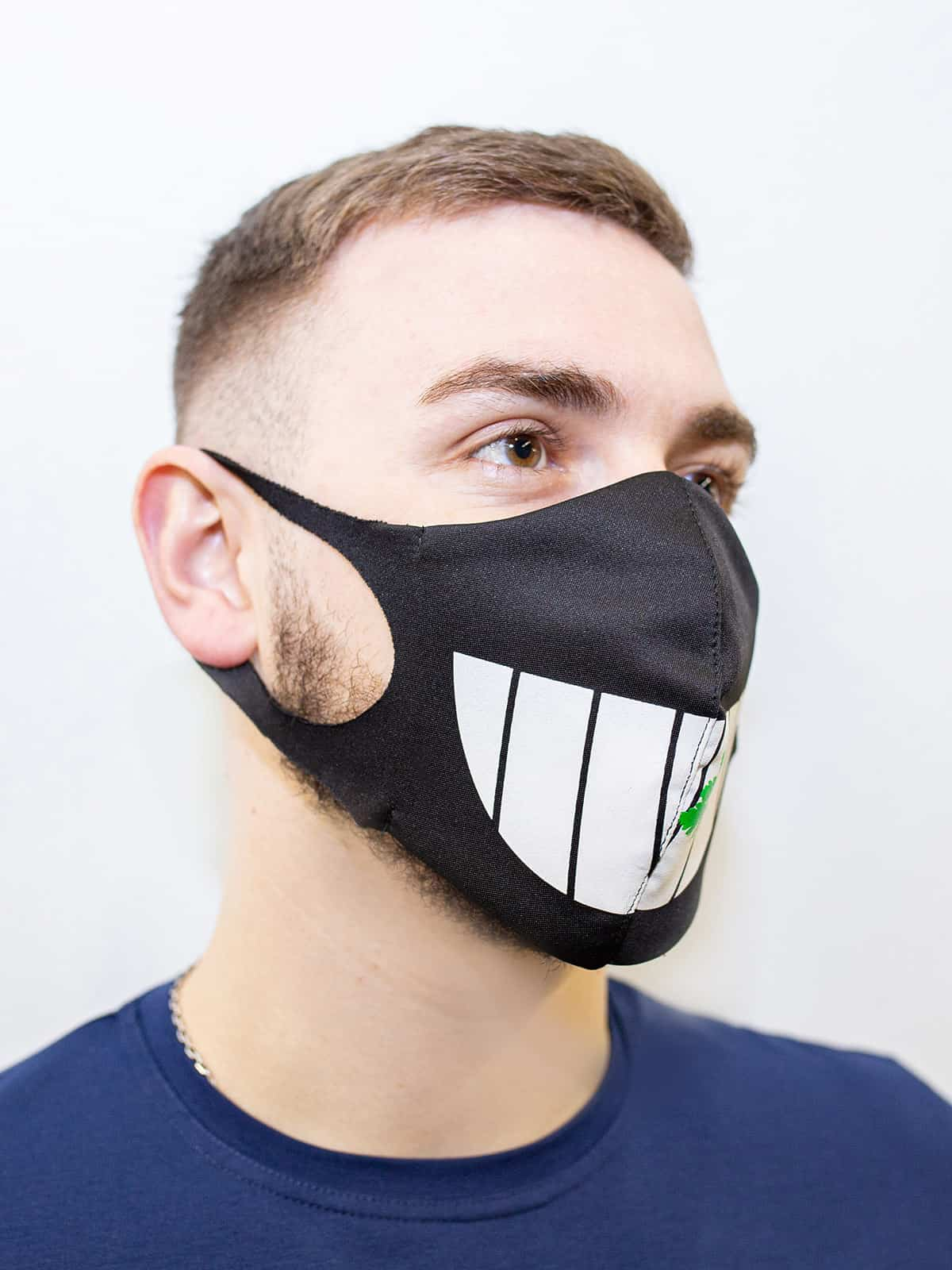 Mask Teeth. Color black. Reusable protective mask with a pocket for a replaceable filter Basic material (outer layer): scuba fabric (rayon 65%, lycra 5%, polyester 30%) – light-weight, elastic and smooth material that dries quickly and fits the face line effectively.