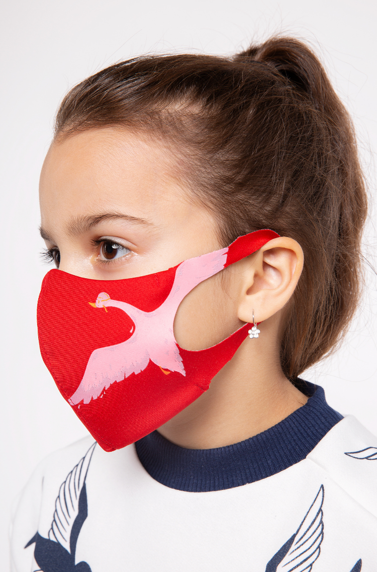 Kids Mask Goose. Color red.  There is a knitwear lining/pocket from the inside (95% cotton, 5% elastane) for the replaceable filter.