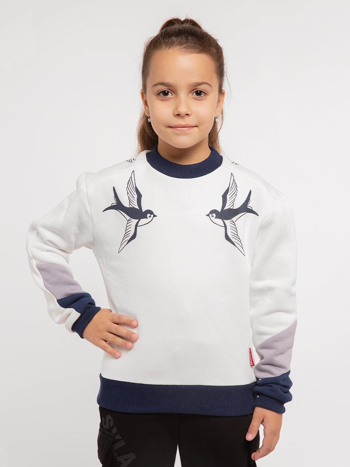 Kids Sweatshirt Swallow. Color white. Three-cord thread fabric: 77% cotton, 23% polyester.