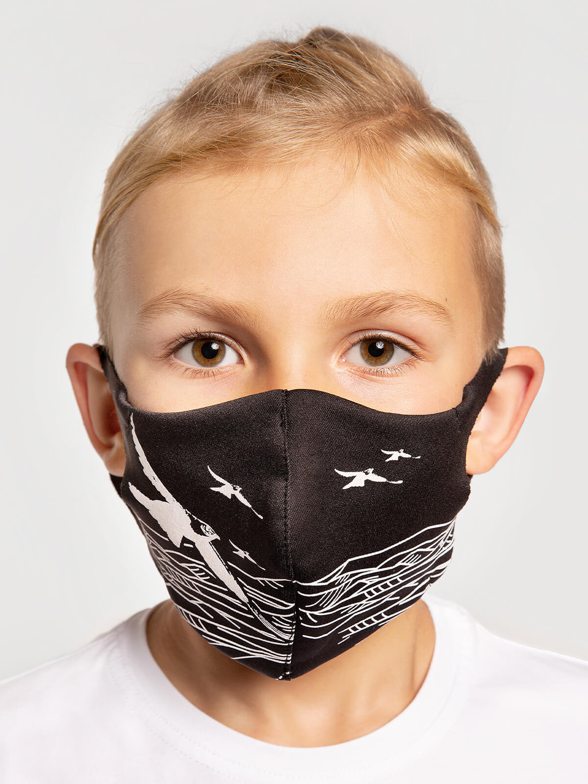 Kids Mask Mountains. Color black.  Reusable protective mask with a pocket for a replaceable filter Basic material (outer layer): scuba fabric (rayon 65%, lycra 5%, polyester 30%) – light-weight, elastic and smooth material that dries quickly and fits the face line effectively.