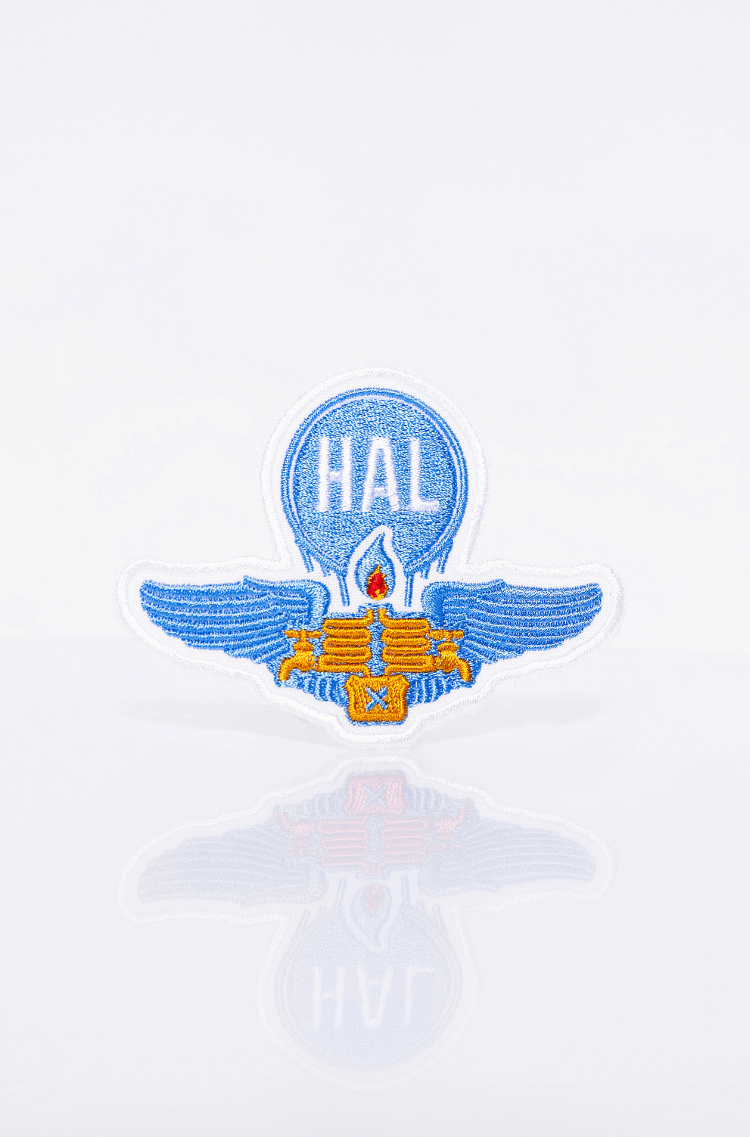 Stripe Hal. Color sky blue. A chevron that tells about the times when one could not only tank the burner but also draw off some fuel from it :) It is a symbol of romance; it helps to muster up the courage to embark on a special adventure.